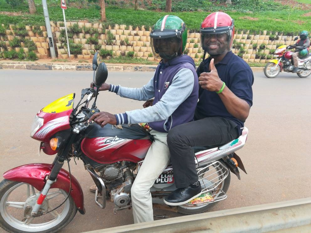 Tony on a bike in Kigali
